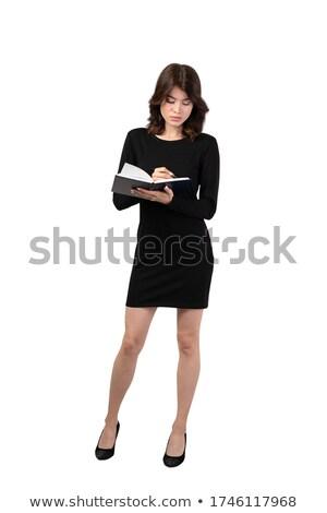entreprise · femme · posant · presse-papiers · stylo · caméra - photo stock © stockyimages