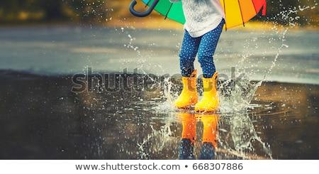 Rain boot and a yellow umbrella Stock photo © Grazvydas