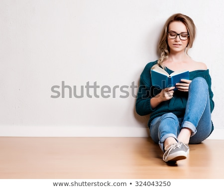 Woman reading book on the floor Stock photo © photography33