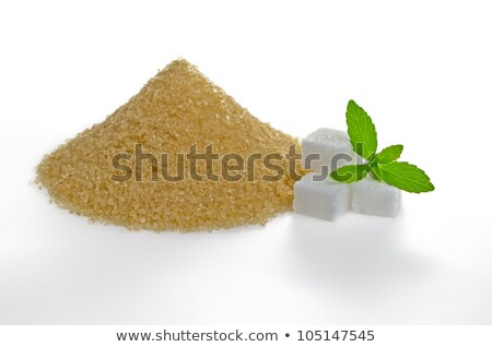 stevia leaves with sugar cubes and a brown sugar heap stock photo © zerbor