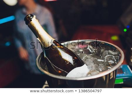 champagne · bottiglia · ghiaccio · secchio · flauto · occhiali - foto d'archivio © discovod