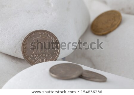 greek drachma coins on a white stones stock photo © capturelight