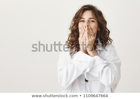 Woman trying not to laugh. Stock photo © photography33