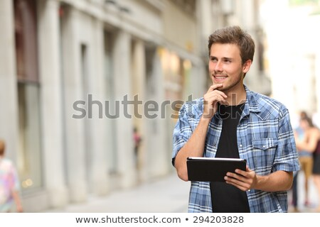 business man with tablet looks away pensively stock photo © feedough