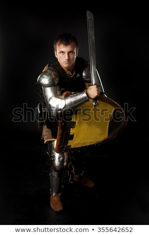 Stock photo: Medieval knight in attack position.