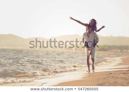 happy couple on beach in love stock photo © monkey_business