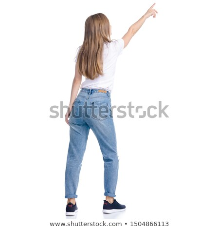 Rear view of a young woman pointing Stock photo © bmonteny