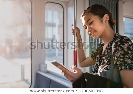 nő · mosolyog · laptop · gyönyörű · nő · mosolyog · gyomor · kanapé - stock fotó © dash