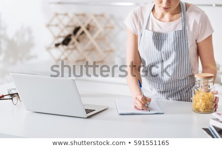 Housewife writing down recipe ingredients Stock photo © stokkete
