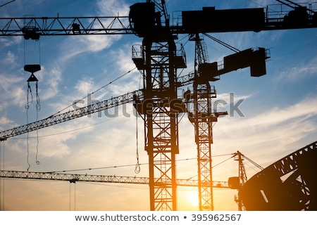 Cranes and building construction on the background of clouds Stock photo © AlisLuch