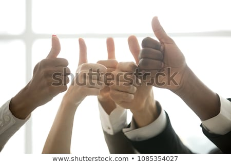 Raised thumb up for approval Stock photo © stevanovicigor