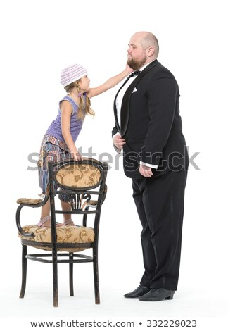 Stockfoto: Little Girl And Servant In Tuxedo Have Fun