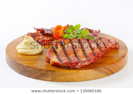 Stock photo: Smoked pork neck with mustard