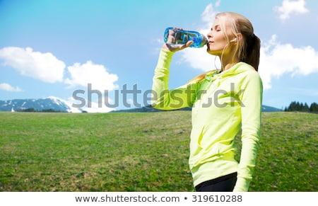 Boldog nő fülhallgató fut kék ég fitnessz Stock fotó © dolgachov