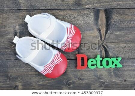 Gyerek cipők szó detoxikáló fa asztal iroda Stock fotó © fuzzbones0