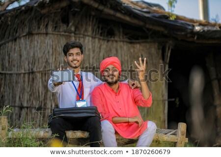 Asian farmer showing a direction. Stock photo © RAStudio
