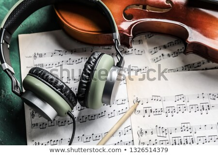 Musical instrument with sheet music on table Stock photo © wavebreak_media