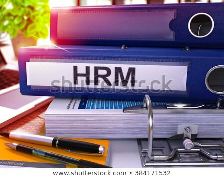 Blue Office Folder with Inscription HRM. Stock photo © tashatuvango