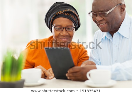 african elderly woman with a tablet stock photo © studiostoks