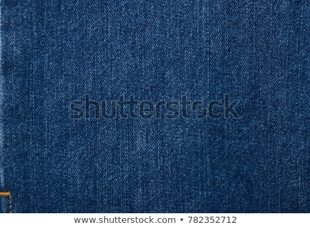 Denim textured background with hole Stock photo © ivelin