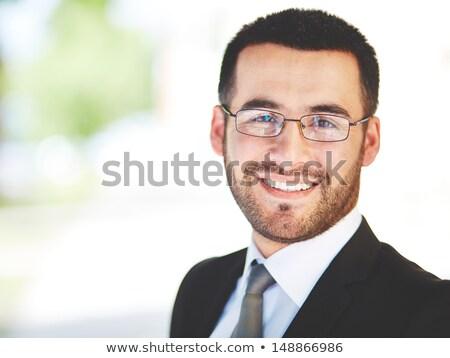 вид сбоку улыбаясь деловой человек очки сидят Сток-фото © deandrobot
