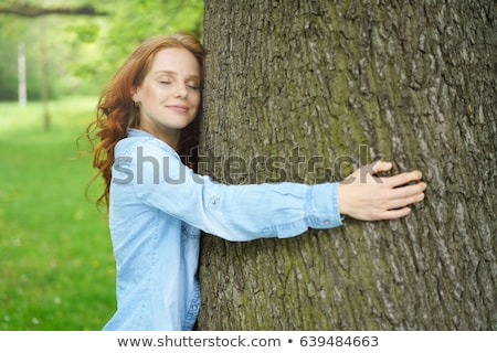 Smiling woman hugging tree Stock photo © IS2