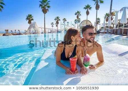 Infinito piscina hombre verano femenino Foto stock © IS2