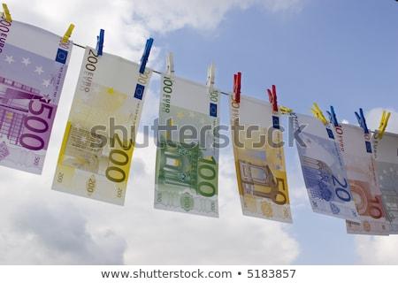 Bankjegyek ruhaszárító pénz bűnözés senki bent Stock fotó © IS2