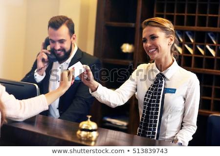 Hotel receptionist praten business bagage receptie Stockfoto © IS2