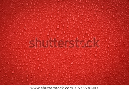 Water drop on a red background Stock photo © joannawnuk