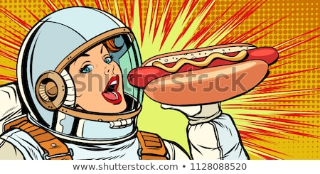 Faim femme astronaute manger hot dog saucisse Photo stock © studiostoks