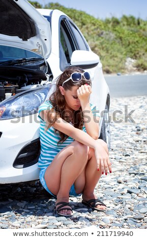 Woman Sitting On Road Near Breakdown Car Stock photo © AndreyPopov