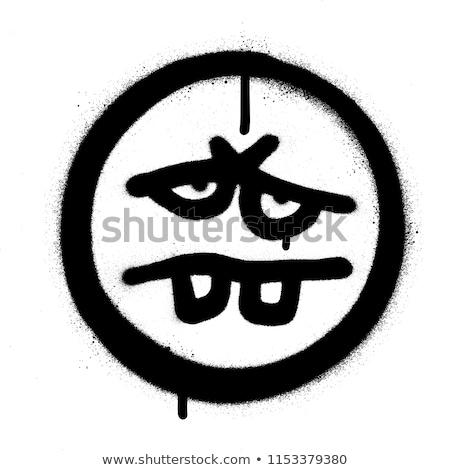 Foto d'archivio: Graffiti Tired Emoticon Sprayed In Black Over White