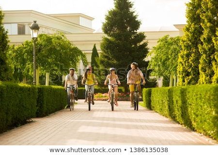 young beautiful woman riding a bicycle in a park active people outdoor stock photo © galitskaya