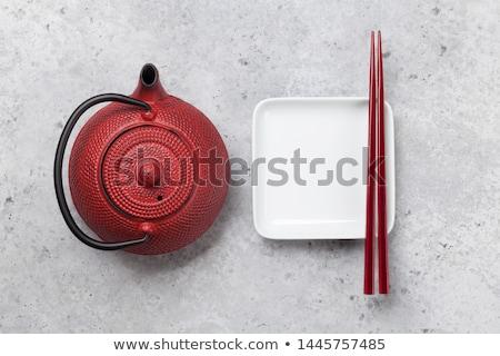 empty plate cup teapot and chopsticks stock photo © karandaev