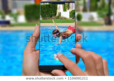 Happy girl is jumping in the smart phone pool Stock photo © sgursozlu