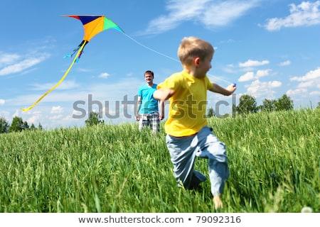 父から息子 演奏 草原 家族 春 笑顔 ストックフォト © Lopolo