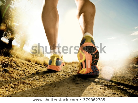 Stock photo: Close up on shoes, athlete runner feet running on track to begin
