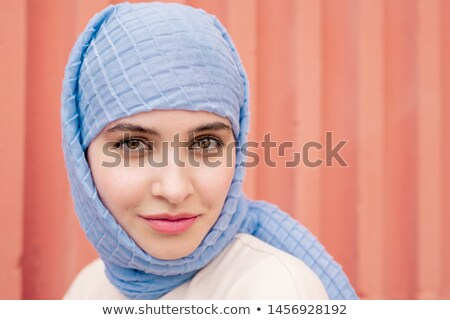Fiatal derűs iszlám nő kék hidzsáb Stock fotó © pressmaster