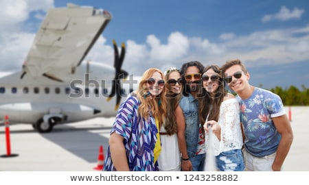 friends or tourists taking selfie over airport Stock photo © dolgachov