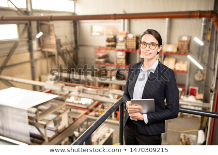 Young successful technical manager in formalwear working in warehouse Stock photo © pressmaster
