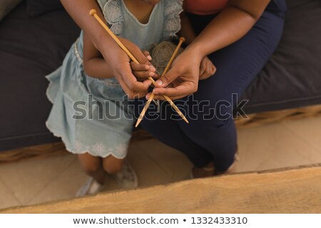 High angle view of African American grandmother teaching her granddaughter how to knitt in living ro Stock photo © wavebreak_media