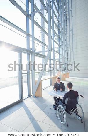 Magas kilátás kaukázusi üzletember ül tolószék Stock fotó © wavebreak_media