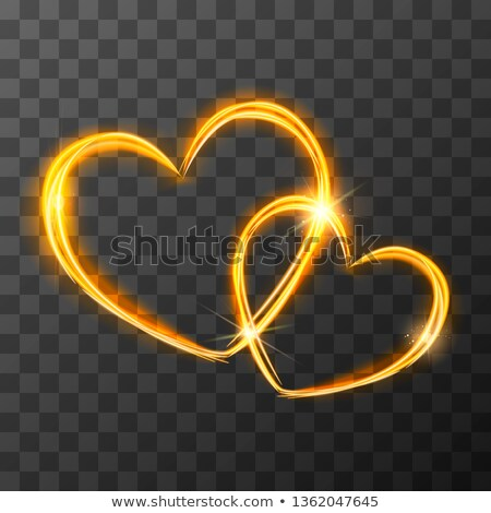 Bright golden light traces in two crossed hearts shape with magic light and sparkles, love concept o Stock photo © evgeny89