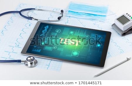 Tablet pc and medical stuff Stock photo © ra2studio