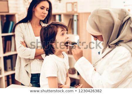 Muslim female doctor in hospital examining a little boy stock photo © zurijeta