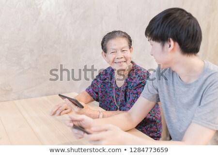 fiatalember · idős · nő · étterem · étel · bor · férfi - stock fotó © photography33