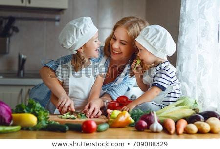fiatal · szakács · ebéd · konyha · zöldségek · munka - stock fotó © vladacanon