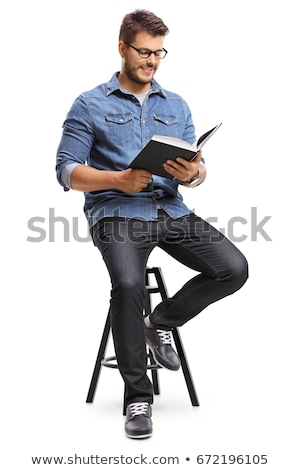 Man reading a hardcover book Stock photo © lovleah