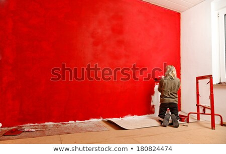 Female decorator with a red roller stock photo © photography33